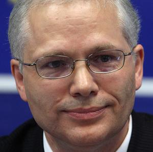 Istvan Szekely said the Government should lower prices for medical care, pharmacies and legal services