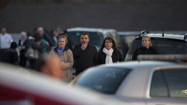 NEWTOWN, CT - DECEMBER 14:  People walk on Dickson Street near the scene of an elementary school shooting on December 14, 2012 in Newtown, Connecticut. According to reports, there are about 27 dead, 18 children, after a gunman opened fire in at the Sandy Hook Elementary School. The shooter was also killed.  (Photo by Douglas Healey/Getty Images)