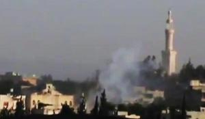 In this image made from amateur video released by Shaam News Network and accessed Monday, June 11, 2012, purports to show smoke near a mosque from Syrian government forces shelling in Rastan town in Homs province, Syria. Syrian troops attacked a central, rebel-held town with helicopter gunships Monday and shelled other restive areas across the nation, activists said. The aerial assault targeted the strategic river crossing town of Rastan, which has resisted repeated government offensives for months, the activists said. (AP Photo/Shaam News Network via AP video) TV OUT, THE ASSOCIATED PRESS CANNOT INDEPENDENTLY VERIFY THE CONTENT, DATE, LOCATION OR AUTHENTICITY OF THIS MATERIAL