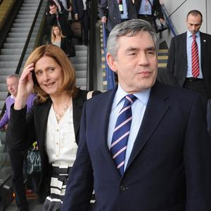 Gordon Brown and his wife Sarah arrive at Birmingham International railway station on the General Election campaign trail
