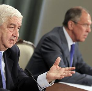 Syrian foreign minister Walid Moallem, left, speaks during a news conference with Russian foreign minister Sergey Lavrov in Moscow (AP)