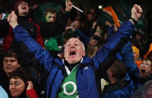 AUCKLAND, NEW ZEALAND - SEPTEMBER 17:  Irish fans celebrate victory at the final whistle during the IRB 2011 Rugby World Cup Pool C match between Australia and Ireland at Eden Park on September 17, 2011 in Auckland, New Zealand.  (Photo by Sandra Mu/Getty Images)