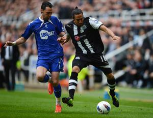 NEWCASTLE UPON TYNE, ENGLAND - APRIL 09: Jonas Gutierrez of Newcastle battles Chris Eagles of Bolton during the Barclays Premier League match between Newcastle United and Bolton Wanderers at the Sports Direct Arena on April 9, 2012 in Newcastle upon Tyne, England.  (Photo by Michael Regan/Getty Images)