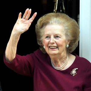 Baroness Thatcher waves to wellwishers from her Belgravia home, after she left the Cromwell Hospital