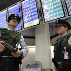 Armed police officers stand guard at a German airport (AP)