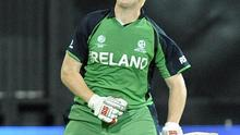 Kevin O'Brien celebrates scoring a century during the ICC Cricket World Cup match against England
