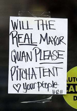 OAKLAND, CA - NOVEMBER 13:  A note to Mayor Jean Quan hangs on the door of City Hall on November 13, 2011, in Oakland, California. In the wake of violent confrontations with police, vandalism and the recent shooting near the encampment, Oakland mayor Jean Quan and city administrators have issued eviction notices to protesters at the Occupy Oakland encampment and have asked them to leave immediately.  (Photo by Mathew Sumner/Getty Images)