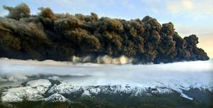 Smoke billows from an erupting volcano by the Eyjafjallajokull glacier. Airspace from Ireland to Finland closed following eruption of the volcano