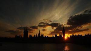 The sun sets over the Houses of Parliament, London, as an ash cloud from an Icelandic volcano grounded all but emergency flights above the UK