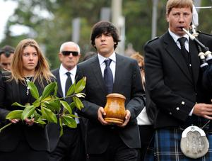 PEDRENA, SPAIN - MAY 11:  Javier Ballesteros (C) carries the urn containing the ashes of his father besides his sister Carmen (L) during the funeral service held for legendary Spanish golfer Seve Ballesteros on May 11, 2011 in Pedrena, Spain. Top-ranked golf players have joined family members and friends to pay their last respects to the late golf great, who died on May 7, 2011 from complications arising from a brain tumor, in his home town parish church.  (Photo by Jasper Juinen/Getty Images)