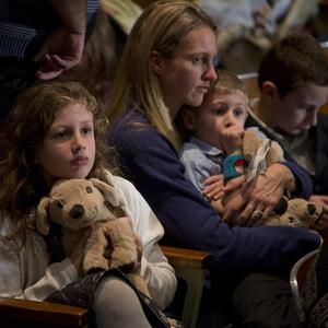 Residents wait for the start of an interfaith vigil for the victims of the Sandy Hook Elementary School shooting (AP)
