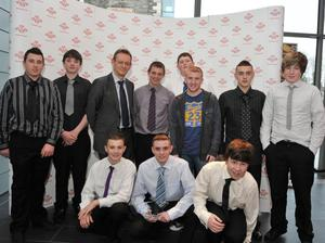D'Tach Youth accept their award from Paul Connolly, Managing Editor Belfast Telegraph (3rd from left) and Commonwealth Games Gold Medal Winner Paddy Barnes (3rd from right)