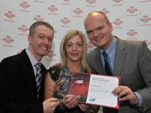 Claire accepts her award from Brian Moreland from Moy Park (left) and the BBc's Ralph McLean
