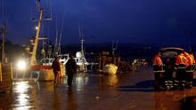Rescue personnel on the pier at Union  Hall in west Cork, after five people went missing after the Tit Bonhomme trawler struck rocks at the mouth of the harbour in the early hours of this morning.