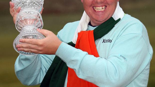 Shane Lowry with the winners trophy after winning on the third play-off hole during the final round of The 3 Irish Open at County Louth Golf Club
