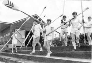 The Methodist College Craig Cup crew make their way to their boat at Stranmillis for a training session on the Lagan. The boys, they are all under fifteen, train four days each week, rowing six miles per day for Craig Cup race which will be held on the Bann at Coleraine in June, 1970.