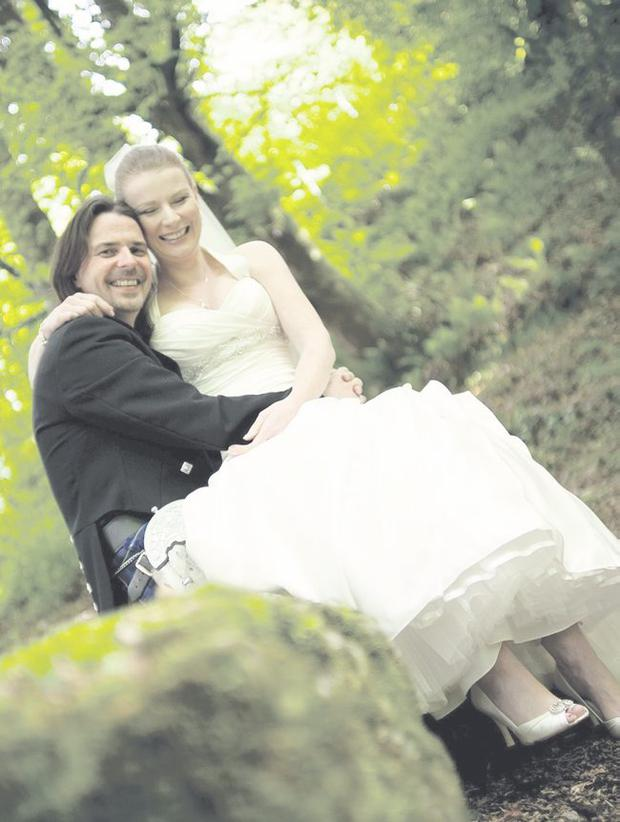 """John and Anne are all smiles at Glenoe Waterfall   <p><b>To send us your Wedding Pics <a  href=""""http://www.belfasttelegraph.co.uk/usersubmission/the-belfast-telegraph-wants-to-hear-from-you-13927437.html"""" title=""""Click here to send your pics to Belfast Telegraph"""">Click here</a> </a></p></b>"""