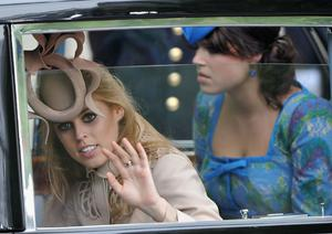 LONDON, ENGLAND - APRIL 29:  Princess Beatrice (L) of York and Princess Eugenie of York make the journey by carriage procession to Buckingham Palace following the Royal Wedding of Prince William, Duke of Cambridge and Catherine, Duchess of Cambridge at Westminster Abbey on April 29, 2011 in London, England. The marriage of the second in line to the British throne was led by the Archbishop of Canterbury and was attended by 1900 guests, including foreign Royal family members and heads of state. Thousands of well-wishers from around the world have also flocked to London to witness the spectacle and pageantry of the Royal Wedding.  (Photo by Pascal Le Segretain/Getty Images)
