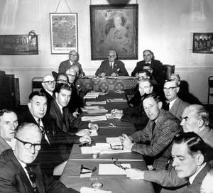 The Ulster Covenant Jubilee Commemoration Committee meet in Unionist Headquarters, Belfast.  Presiding was Mr John Bryans, chairman and Grand Master of the Belfast County Grand Orange Lodge.  Beside him are Mr H Radcliffe (right) and Mr RJ McMullan, general secretary.  8/9/1962