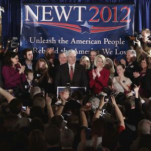 Newt Gingrich speaks as his wife Callista looks on during a Republican primary night rally in Columbia, South Carolina (AP)