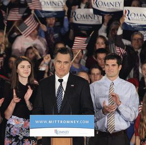 Mitt Romney addresses a South Carolina primary rally with, from left, wife Ann, son Tagg, granddaughter Allie, son Matt and granddaughter Chloe (AP)