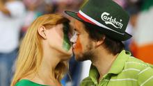 Republic of Ireland fans share a kiss   at The Municipal Stadium on June 10, 2012 in Poznan, Poland.
