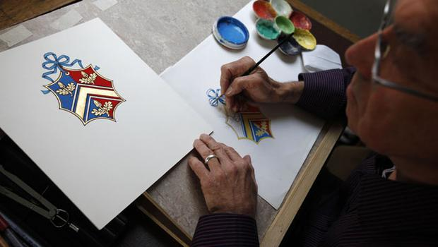 LONDON, ENGLAND - APRIL 18:  Herald Painter, Robert Parsons, sketches the new Coat of Arms for Catherine Middleton's family at the College of Arms in London on April 18, 2011 in London England.  Catherine Middleton will use this Coat of Arms until her April 29th royal wedding to Britain's Prince William, when it will be merged with his Coat of Arms. (Photo by Suzanne Plunkett - WPA Pool / Getty Images) *** Local Caption *** Robert Parsons;