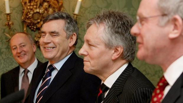 Secretary of State for Northern Ireland (far left) looks on as Prime Minister Gordon Brown (centre left), DUP leader Peter Robinson (centre right) and Sinn Fein's Martin McGuinness (right) speak during a press conference after a deal was announced about Northern Ireland's power-sharing government.