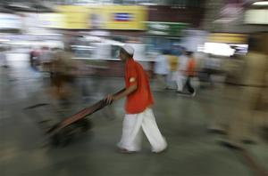 A worker pushes his handcart inside a waiting room at  Chhatrapati Shivaji railroad station where attacks began Wednesday with shooters spraying gunfire in Mumbai, India, Saturday, Nov. 29, 2008. Indian commandos killed the last remaining gunmen holed up at a luxury Mumbai hotel Saturday, ending a 60-hour rampage through India's financial capital by suspected Islamic militants that killed people and rocked the nation. (AP Photo/Altaf Qadri)