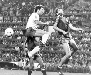 Gerry Armstrong (left) who was a constant thorn in the Spanish defence leaps high to contest the ball in the Spanish penalty area but is beaten by a head by Alonso.