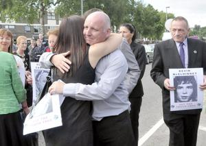 Families of the victims of the Bloody Sunday shootings march from the Bogside to the Guildhall holding photographs of their relatives, to gain a preview of the Saville Report on June 15, 2010