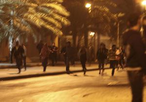 Anti-government demonstrators flee after being attacked by Bahraini riot police at the Pearl roundabout in Manama, Bahrain.