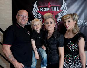 Julian Carson at the opening of his Kapital Ink tattoo studio with his son Jude, wife Marie and daughter Julieann