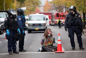 PORTLAND - NOVEMBER 13: A young protester shouts after he was placed in handcuffs and arrested near the Occupy Portland encampment November 13, 2011 in Portland, Oregon. Portland police have reclaimed the two parks in which occupiers have been camping after a night of brinksmanship with protesting crowds of several thousands. (Photo by Natalie Behring/Getty Images)