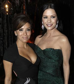 Eva Longoria, left, and Catherine Zeta-Jones arrive at the Weinstein Company Golden Globes after party Sunday, Jan. 16, 2011, in Beverly Hills, Calif. (AP Photo/Matt Sayles)