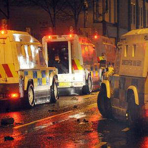 Police on patrol during disturbances which erupted in east Belfast