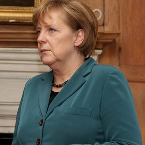 German Chancellor Angela Merkel has attended a memorial for the victims of the Love Parade tragedy