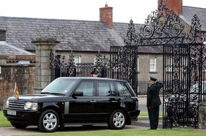 Queen Elizabeth II arrives through the new Jubilee Gates at Hillsborough Castle, County Down, during a two-day visit to Northern Ireland as part of the Diamond Jubilee tour. PRESS ASSOCIATION Photo. Picture date: Tuesday June 26, 2012. See PA story ROYAL Queen. Photo credit should read: Paul Faith/PA Wire