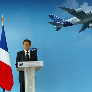 France's President Nicolas Sarkozy delivers his speech during the opening of the Paris Air Show at le Bourget, east of Paris (AP)
