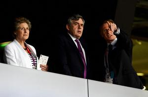 LONDON, ENGLAND - JULY 27:  (L-R) Norma Major, Gordon Brown and Chief Executive of LOCOG Paul Deighton during the Opening Ceremony of the London 2012 Olympic Games at the Olympic Stadium on July 27, 2012 in London, England.  (Photo by Pascal Le Segretain/Getty Images)