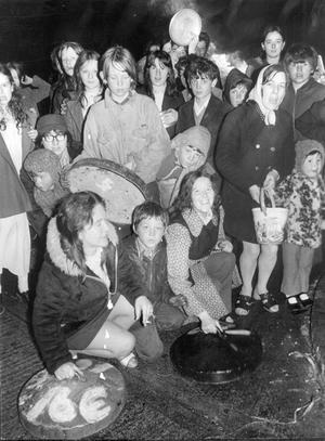 Its four o'clock this morning, and women and children of the New Lodge Road area of Belfast turn out for their bin lid banging protest on the first anniversaryof internment.  9/8/1972