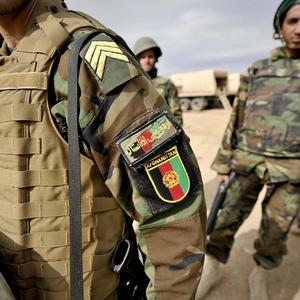 Nato says a person wearing an Afghan national security force uniform shot dead three civilian contractors working with the coalition