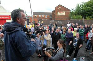 Sinn Féin MLA Gerry Kelly speaks to residents in Ardoyne during a rally at Brompton Park to highlight opposition against those who have been  rioting in the area in recent nights