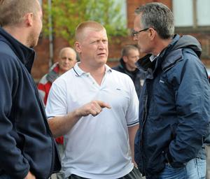 Ardoyne resident Eddie Copeland speaking with Gerry Kelly - Ardoyne residents gather to protest about the recent rioting in the area