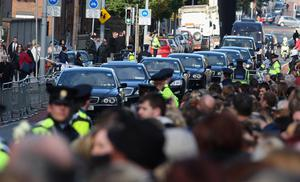 Guests arrive at the funeral of Boyzone singer Stephen Gately at St Laurence O'Toole Church in Dublin