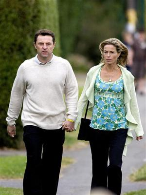 Kate and Gerry McCann, parents of missing toddler Madeleine, walk to mass y  at their local Catholic church, the Sacred Heart in Rothley, England