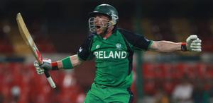 John Mooney of Ireland celebrates after scoring the winning runs during the 2011 ICC World Cup Group B match between England and Ireland at the M. Chinnaswamy Stadium on March 2, 2011