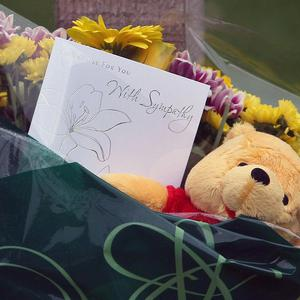 Flowers left on Slateford Road, Edinburgh, after three children were found dead in their home following reports of an explosion