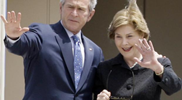 George Bush and wife Laura arrive in Belfast today for a meeting with Northern Ireland's leaders at Stormont