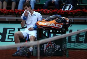 Andy Murray looks dejected during his men's singles fourth round match with Tomas Berdych of Czech Republic at the French Open